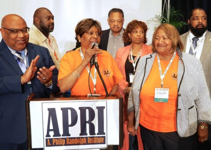 APRI president Clayola Brown (c) and Jesse Jackson ( rear) and Loretta  Johnson (right to Brown) Secretary Treasurer - American Federation of Teachers Union with Congresswoman Brenda Lawrence (D-MI) and , APRI Board members
