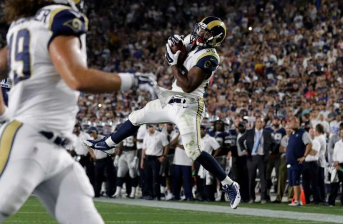 Los Angeles Rams running back Aaron Green leaps to make a catch against the Dallas Cowboys in the second half of a preseason NFL football game, Saturday, Aug. 13, 2016, in Los Angeles. Green ran the reception in for a touchdown (Ryan Kang, AP)