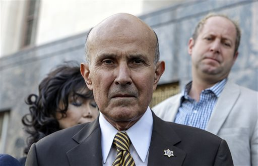 """Former Los Angeles Sheriff Lee Baca, middle, leaves the U.S. Court House building in Los Angeles on Wednesday, Feb. 10, 2016. Baca signed a plea agreement that said he ordered deputies to intimidate an FBI agent and """"do everything but put handcuffs on her."""" Baca later lied to federal prosecutors and the FBI that he wasn't privy to discussions about trying to derail the investigation. (AP Photo/Nick Ut)"""