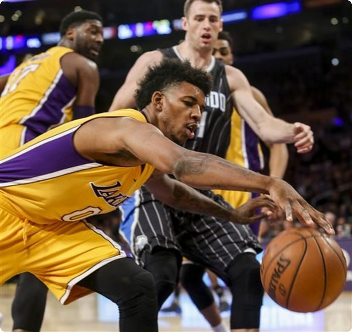 Los Angeles Lakers forward Nick Young tries to save the ball during the first half of the team's NBA basketball game against the Orlando Magic on Tuesday, March 8, 2016, in Los Angeles. (AP Photo/Ringo H.W. Chiu)