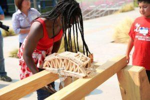 NOMA Camp youth working on stress test bridge project.Photos Courtesy of foxxmedia