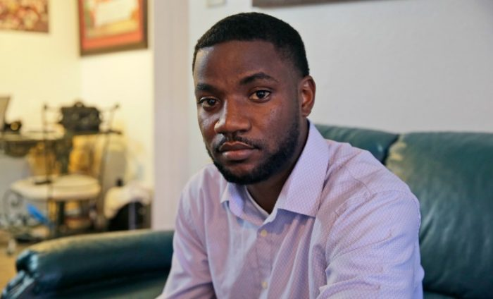 FILE - In this Thursday, Aug. 25, 2016, file photo, Dominique Alexander poses for a photo at his apartment in Dallas. Alexander, a leader of the protest where a sniper killed multiple law enforcement officers in Dallas was ordered to prison Friday, Aug. 26, 2016, for unrelated probation violations. (AP Photo/LM Otero, File)