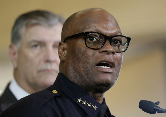 Dallas police chief David Brown, front, and Dallas mayor Mike Rawlings, rear, talk with the media during a news conference in Dallas. (AP Photo/Eric Gay)