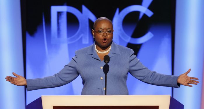 Rev. Leah D. Daughtry, CEO of the Democratic National Convention, welcomes delegates to the convention in Denver, Monday, Aug. 25, 2008.  (AP Photo/Ron Edmonds)