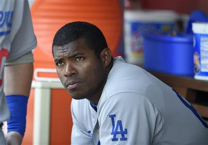 FILE - This July 21, 2016 file photo shows Los Angeles Dodgers' Yasiel Puig looking on from the dugout during a baseball game against the Washington Nationals in Washington. Puig's agent said Monday, Aug. 1, 2016 the Los Angeles Dodgers slugger expects to be sent to the minors after the club was unable to trade him at the deadline. (AP Photo/Nick Wass)