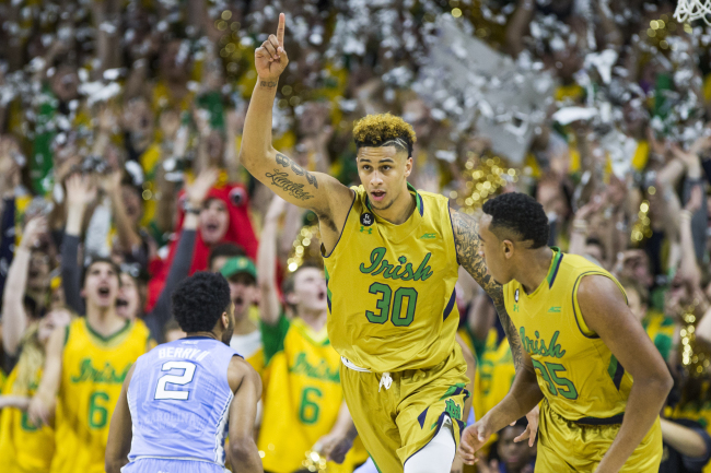 Notre Dame's Zach Auguste (30) celebrates after scoring the team's first basket of the night against North Carolina, in an NCAA college basketball game Saturday, Feb. 6, 2016, in South Bend, Ind. (AP Photo/Robert Franklin)