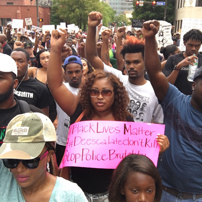 Protestors march in the street following the shooting death of Alton Sterling in Baton Rouge, La. (The Drum)