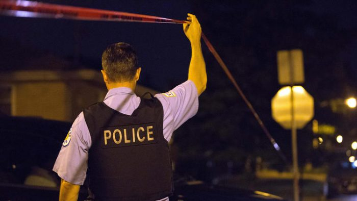 Chicago police investigate after two people were shot in the 1000 block of West 97th Street on Aug 25, 2016, in the Longwood Manor neighborhood. (Erin Hooley / Chicago Tribune)