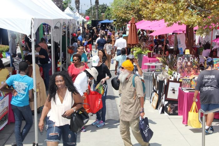 Thousands of book lovers flocked to the 10th Annual Leimert Park Village Book Fair at the outdoor promenade of the Baldwin Hills Crenshaw Plaza on Aug. 20 in Los Angeles. Photo by Malcolm Ali