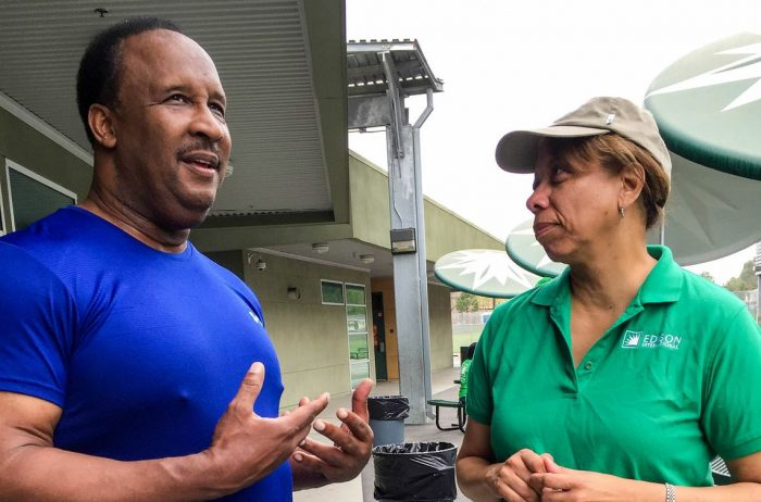 Inglewood Mayor James Butts and Janet Clayton, Edison International Corporate Communications Senior Vice President, chat about the importance of building a community garden for kids. (Photo by Glennetta Green)