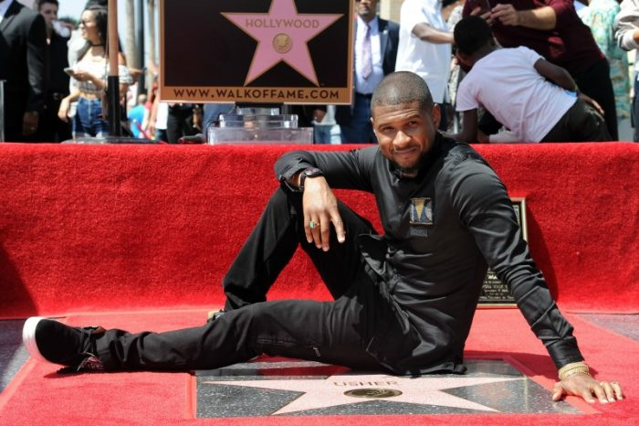 Usher attends a ceremony honoring him with a star on the Hollywood Walk of Fame on Wednesday, Sept. 7, 2016, in Los Angeles. (Photo by Richard Shotwell/Invision/AP)