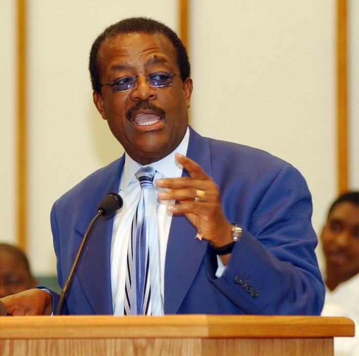 Defense attorney Johnnie Cochran speaks at a local prayer rally for prison journalist Wilbert Rideau on Sunday, June 1, 2003, in Lake Charles, La. Defense lawyers want a fourth murder trial of Rideau to be in Baton Rouge, La., and not Lake Charles. The lawyers filed court papers Friday saying that the 19th Judicial District in East Baton Rouge has jurisdiction over the 1961 murder case since a retrial took place there in 1964. (AP Photo/American Press, Ricky Hickman)