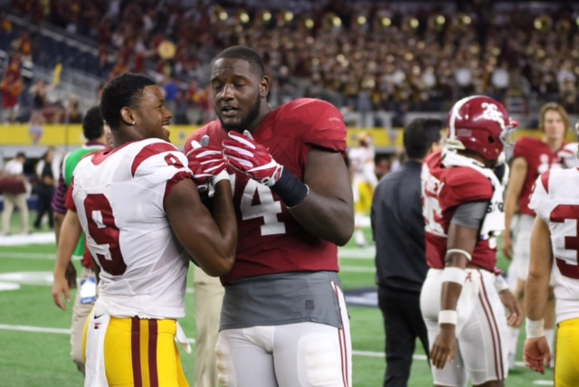 USC WR JuJu Smith-Schuster greets Alabama's Cam Robinson after game.  Photo:   Gregory Redding