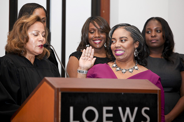 Amber Finch taking the oath of office given by Hon. Yvette D. Roland, CA State Bar Court Judge and BWL Past President (courtesy of Black Women Lawyers)