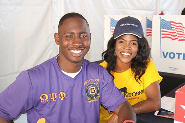 : Volunteers help community members understand their vote. (Photo Credit: Brittany K. Jackson)