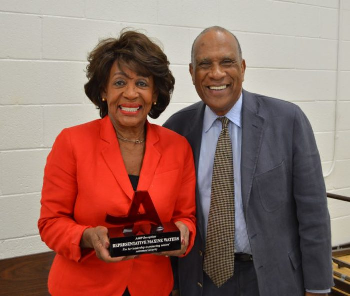 "Los Angeles Area Volunteer Leader David Crippens presents Representative Maxine Waters (CD 43) with AARP's ""Champion of 50+"" award."