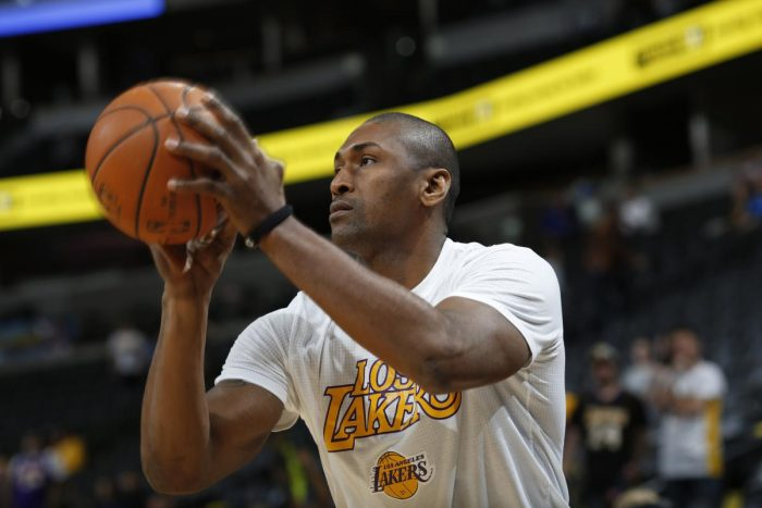 Metta World Peace will get a shot to make the Lakers roster in training camp. (AP Photo/David Zalubowski)
