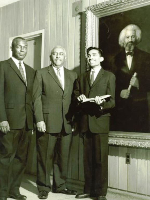 Fisk University leaders standing in front of the newly unveiled painting of Frederick Douglass, which had been donated to the university by W.E.B. Du Bois. (Photo: Department of Special Collections and University Archives, W.E.B. Du Bois Library, University of Massachusetts Amherst)