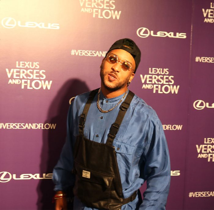"Ro James is fashion forward on the purple carpet, set to perform his hit single ""Already Knew That"" on the Versus & Flow special airing October 26."