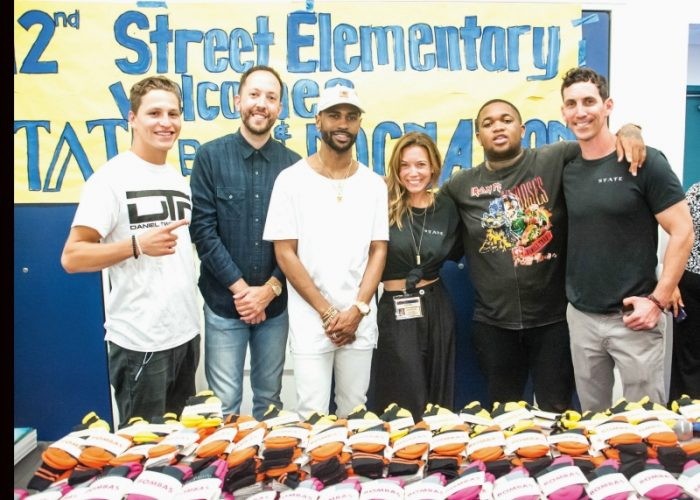 "(L-to-R) Roc Nation boxer, Daniel ""Twitch"" Franco, DJ Reflex, Big Sean, STATE Bags Co-Founder Jacqueline Tatelman, DJ Mustard & STATE Bags Co-Founder Scot Tatelman. Photo By Steve Lucero, (Courtesy Billy Farrell Agency (BFA) )"
