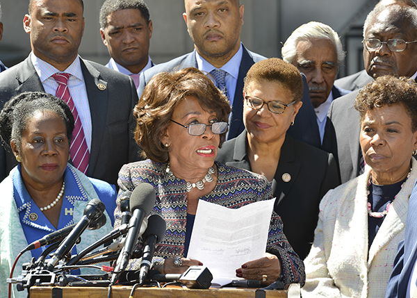 Rep. Maxine Waters (D-Calif.) reads from a letter that was later delivered to the Justice Department. In the letter, CBC members called for the Justice Department to investigate the killings of unarmed Blacks by law enforcement. (Freddie Allen/AMG/NNPA)