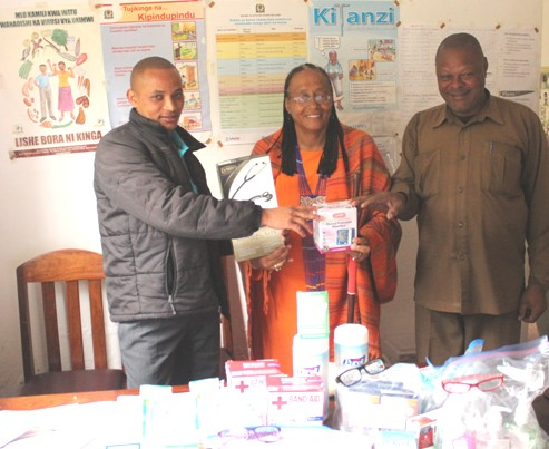 From left are Emanuel Venture, Oldadai medical technician; Mataji, and Lazaro Ishimal, chairman of Oldadai Village, display some of the medical supplies donated.
