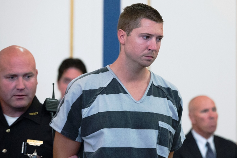 In this July 30, 2015, file photo, former University of Cincinnati police officer Ray Tensing, who shot and killed motorist Sam DuBose during a traffic stop on July 19, 2015, appears for his arraignment at the Hamilton County Courthouse in Cincinnati. (AP Photo/John Minchillo, File)