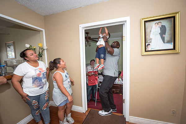 Three free smoke alarms were installed in the home of Francisco Romero and Violeta Lopez. The family made first fire escape plan with Marcellus Wiley. (photo by Mimi Teller)