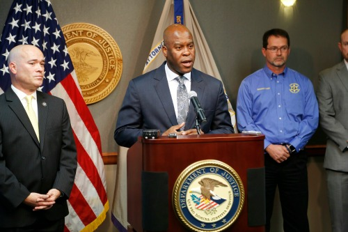 FBI Special Agent in Charge Eric Jackson talks about the FBI's roll in stopping a bomb plot. Acting U.S. Attorney Tom Beall (left) announced Friday a major federal investigation stopped a domestic terrorism plot by a militia group to detonate a bomb at a Garden City apartment complex where a number of Somalis live.Two Liberal men and a Dodge City resident were arrested and charged in federal court with domestic terrorism charges, Beall told reporters at a news conference in downtown Wichita. (Bo Rader/The Wichita Eagle via AP)