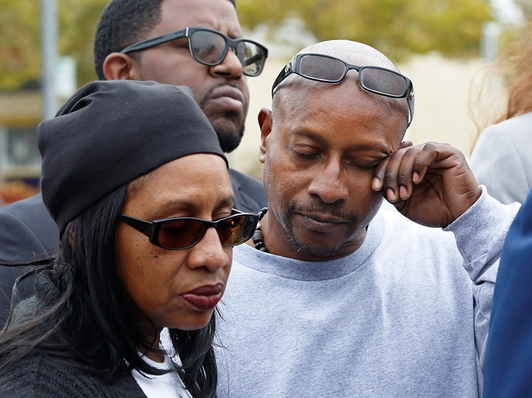 Robert Mann, right, the brother of Joseph Mann, who was killed by Sacramento Police in July, wipes his eye during a news conference Monday, Oct. 3, 2016, in Sacramento, Calif. The Mann family is demanding that the officers involved in shooting of Joseph Mann, 50, be charged with murder and that the U.S. Department of Justice open a civil rights investigation of the Sacramento Police Department. (AP Photo/Rich Pedroncelli)