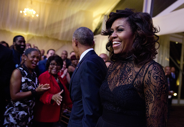 First lady Michelle Obama and President Barack Obama arrive at a BET event on the South Lawn of the White House, in Washington, Friday, Oct. 21, 2016. (AP Photo/Carolyn Kaster)