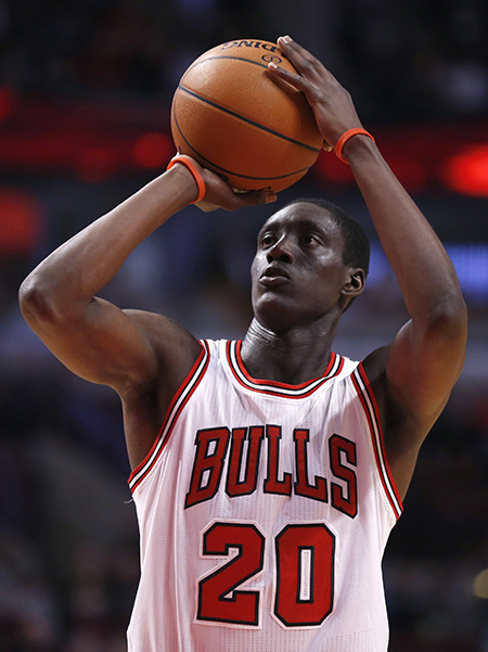 Chicago Bulls forward Tony Snell shoots a free-throw during the second half of an NBA basketball game against the Milwaukee Bucks Monday, Feb. 23, 2015, in Chicago. The Bulls won 87-71. (AP Photo/Charles Rex Arbogast)