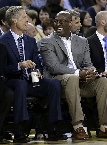 ADVANCE FOR WEEKEND EDITIONS, OCT. 15-16 - FILE - In this Oct. 4, 2016, file photo, Golden State Warriors assistant coach Mike Brown, right, laughs with coach Steve Kerr during the third quarter of a preseason NBA basketball game against the Los Angeles Clippers in Oakland, Calif. (AP Photo/Ben Margot, File)