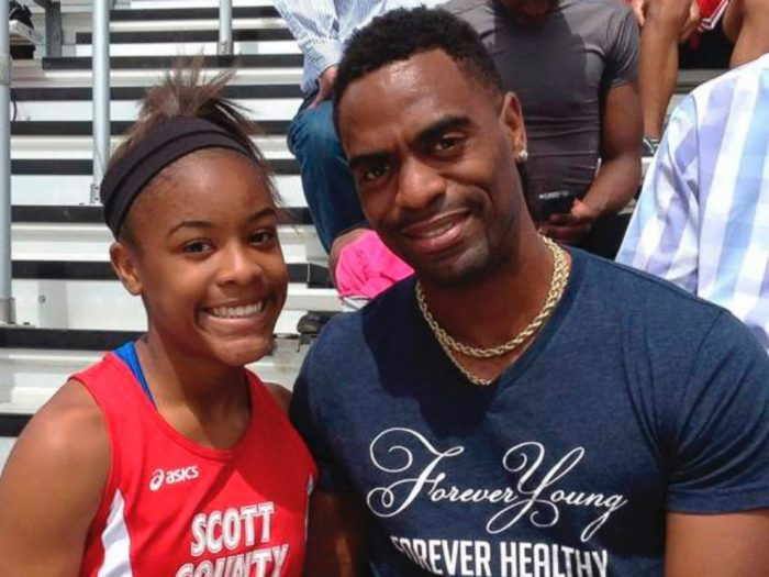 Trinity Gay poses for a photo with her father Tyson Gay.(Mark Maloney/Lexington Herald-Leader via AP)