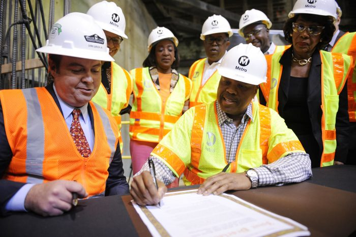 (L-R) Daniel P. Walsh, president of Walsh Shea Construction and Metro CEO Phil Washington signed a proclamation saying they would complete the project by 2019 or possibly sooner. (Photo by Valerie Goodloe)