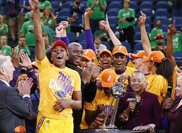 Los Angeles Sparks players celebrate after winning the WNBA championship title with a 77-76 win over the Minnesota Lynx in Game 5 Thursday, Oct. 20, 2016, in Minneapolis. Parker scored 28 points, had 12 rebounds and was named MVP. (AP Photo/Jim Mone)