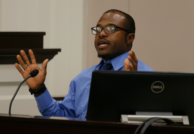 Pierre Fulton, who was in Walter Scott's vehicle when Scott was confronted by North Charleston Police Officer Michael Slager, testifies during the trial of Slager, Thursday, Nov. 3, 2016 in Charleston, (Grace Beahm/Post and Courier via AP, Pool, File)
