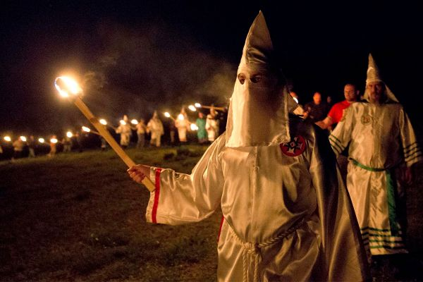 "KKK members participate in a ""white pride"" rally in Georgia in April. (AP photo)"