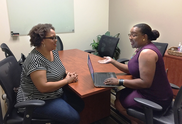 Sherry Davis Johnson (right), a Covered California certified agent in Pasadena, CA, explains health coverage options. (Courtesy Photo)