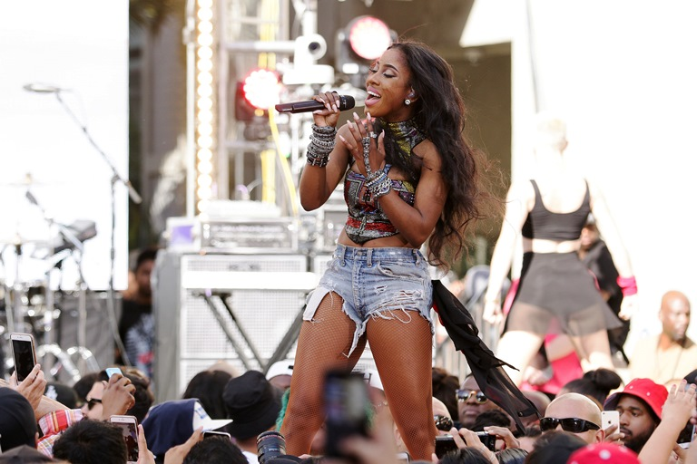 """This April 1, 2015 photo, Sevyn Streeter performs on stage at the """"Furious 7"""" Takeover held at the Revolt Live Studios in Los Angeles. (Photo by John Salangsang/Invision/AP)"""