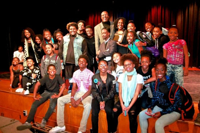 Students gather on stage with Rory Pullens after seeing their peers perform. (Photo by E. Mesiyah McGinnis)