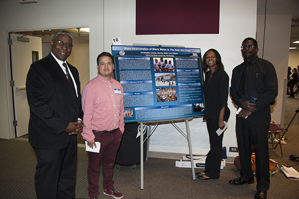 Dr. Cedric Hackett featured with a few of his research students. (Courtesy Photo)