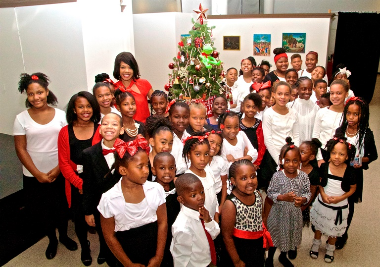 Wendy Raquel Robinson, actress & co-founder of Amazing Grace Conservatory, poses with young artists and visitors as she hosts MAAA's annual Christmas Tree Lighting Ceremony. Mesiyah McGinnis