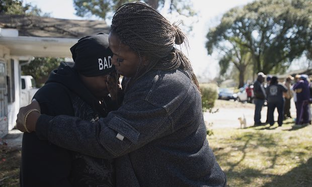Kimberly Gunn, sister of Greg Gunn, is embraced by family friend Pam Blocton while mourning. (Albert Cesare/AP)