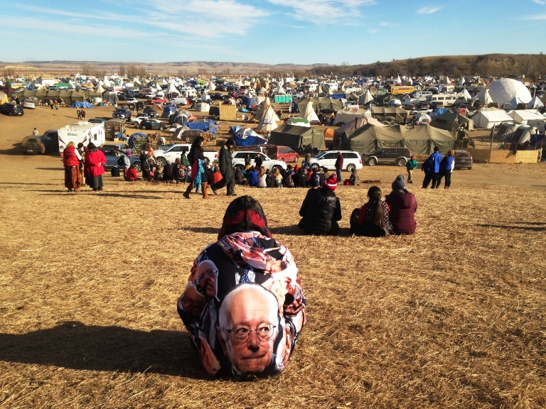 Protesters of the Dakota Access pipeline encampment sits Wednesday, Oct. 26, 2016, on private property near Cannon Ball, N.D., owned by the pipeline developer, Texas-based Energy Transfer Partners. Both the local sheriff and Energy Transfer Partners have said the protesters are trespassing and must leave. (AP Photo/James MacPherson)
