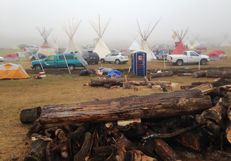 Protesters gather at an encampment on Saturday, Nov. 26, 2016, a day after tribal leaders received a letter from the U.S. Army Corps of Engineers that told them the federal land would be closed to the public on Dec. 5, near Cannon Ball, N.D. The protesters said Saturday that they do not plan to leave and will continue to oppose construction of the Dakota Access oil pipeline. (AP photo/James MacPherson)