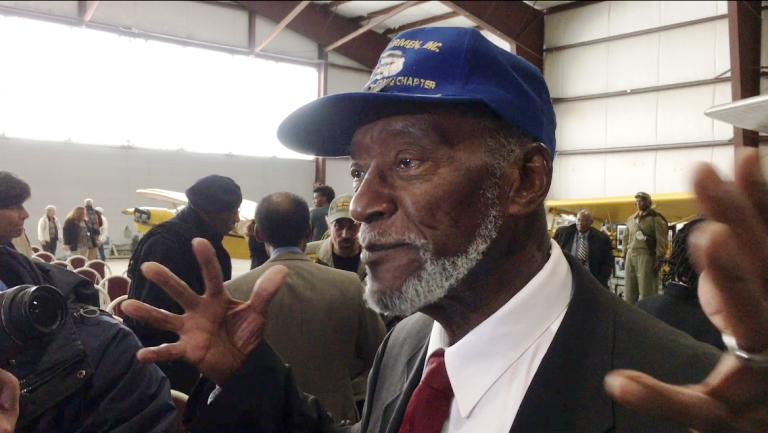 Herbert Thorpe talks to reporters at the National Warplane Museum in Geneseo, N.Y., on Friday, Nov. 11, 2016, after receiving the Congressional Gold Medal for his service more than 70 years ago as a member of the Tuskegee Airmen. Thorpe, one of the military's first black pilots, accepted his own medal and another on behalf of his late brother, Richard Thorpe, who completed fighter pilot training but died in a crash in Italy in 1945. (AP Photo/Carolyn Thompson)