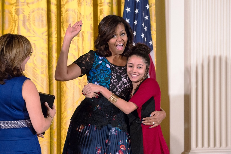 Michelle Obama hugs Noemi Negron at the National Arts and Humanities Youth Program Awards ceremony at the White House. Children from across the nation laughed, hugged and cried as they said goodbye to the first lady, who leaves office with her husband in January. (Photo by Cheriss May, HUNS)