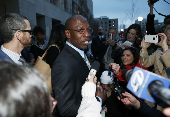 """In this Dec. 22, 2015, file photo, Clarence Moses-EL, center, talks after being released from Denver County jail in Denver. Moses-EL, released from prison last year after spending more than a quarter of a century in prison for a rape he long denied committing, was acquitted of the crime on Monday, Nov. 14, 2016, leaving a courtroom to applause from supporters and chants of """"it's over."""" (AP Photo/David Zalubowski, File)"""