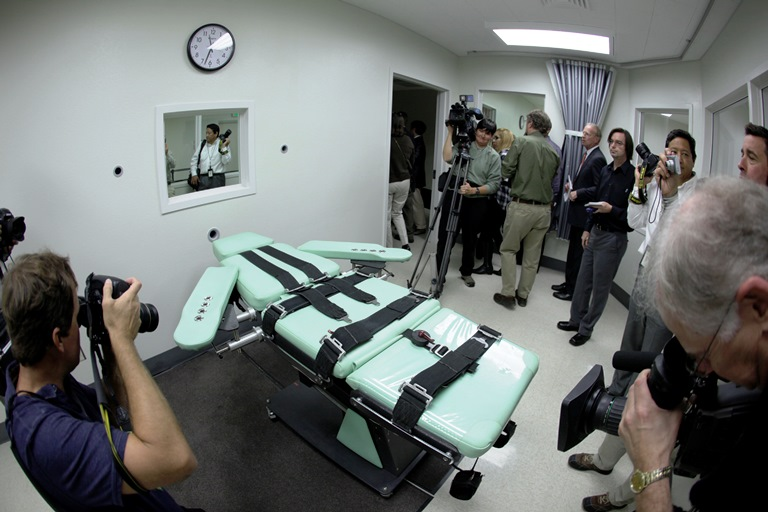 In this Sept. 21, 2010, file photo, people photograph the interior of the lethal injection facility at San Quentin State Prison in San Quentin, Calif. (AP Photo/Eric Risberg, File)